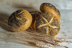 Small bread with poppy seeds and Wheat Stock Photography