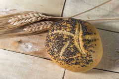 Small bread with poppy seeds and Wheat Stock Image