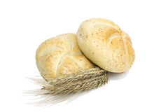 Small bread and wheat ear. On white background Stock Image