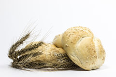 Small bread and wheat ear. On white background Royalty Free Stock Photo