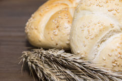 Small bread and wheat ear Royalty Free Stock Photography