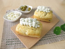 Small breads with herb cheese topping Royalty Free Stock Photos