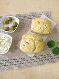 Small breads with olives and feta cheese Stock Photo