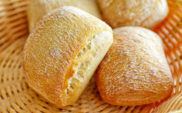 Small breads in village basket Stock Images