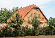 Small brick house with red tiled roof Stock Photography