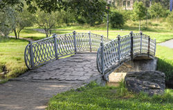 Small bridge. Small stone bridge over stream and walkway Royalty Free Stock Images