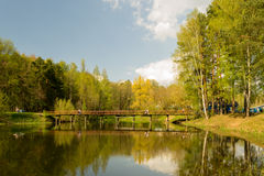 A small bridge across the lake. Autumn landscape Stock Photo