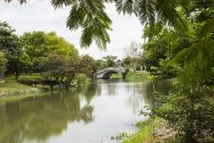 Small bridge across the lake stock photography