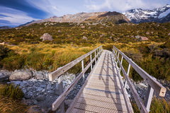 A small bridge along the Hooker Valley track in Mount Cook, New Zealand Royalty Free Stock Photos