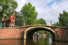 Small bridge in Amsterdam. Stock Photos