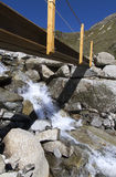 Small bridge crossing a mountain stream Royalty Free Stock Photos
