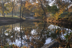 Small bridge on fall creek. In the early morning Stock Images