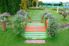 Small bridge in a flower garden Royalty Free Stock Photo