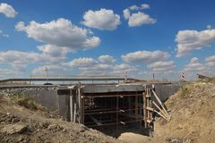 Small bridge on highway or road in reconstruction. Roadworks, small bridge at highway or road on reconstruction with blue sky and clouds Stock Photos