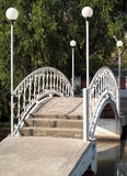 Small bridge with lamp post over the swamp Stock Image