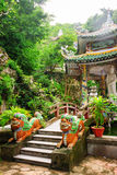 Small bridge leading to Buddha statue at the Linh Ung Pagoda Royalty Free Stock Photography