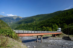 Small bridge over mountain river in Upper Svaneti, Georgia Royalty Free Stock Images