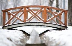 Small bridge over a stream. Small bridge in winter over a park stream, outdoor Stock Image