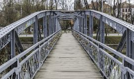 Small Bridge over a urban river Stock Image