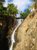 Small bridge over waterfall. In tropical landscape Royalty Free Stock Image