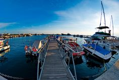 Small bridge in a pier. A picture of a small bridge in a port near ships and boats,in a town in Greece,New Moudania,in a summer day afternoon Royalty Free Stock Photo