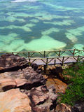 Small bridge in Seychelles. Beautiful  transparent  ocean bottom and clear and a small bridge in Seychelles Royalty Free Stock Photos