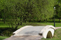 A small bridge in Tsaritsyno park, Moscow, Russia. A small white bridge somewhere in Tsaritsyno park - Moscow, Russia stock photography