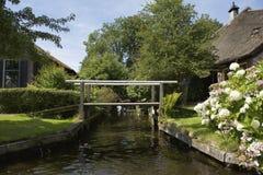 Small bridge (vonder) in the village Dwarsgracht Stock Photos
