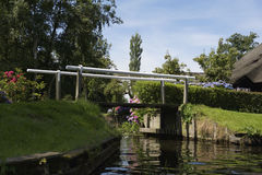 Small bridge (vonder) in the village Dwarsgracht Royalty Free Stock Image