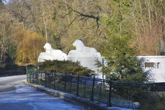 Small bridge whith lion sculptures. Zagreb, Croatia – January 7, 2017: Small bridge whith white lion sculptures in Zagreb Zoo, Croatia Stock Images