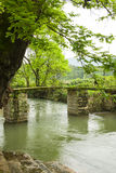 The small bridges and flowing water Stock Photography