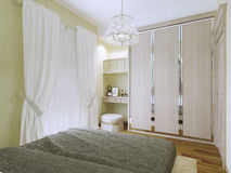 Small bright art deco bedroom trend Stock Photo