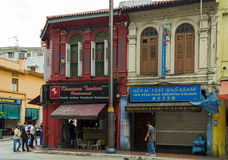 Small and bright buildings in the city. Street in Little India quarter in Singapore Royalty Free Stock Images
