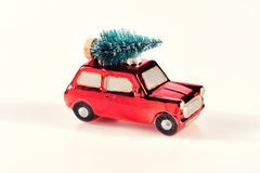 Small bright red toy car with Christmas tree Stock Photos