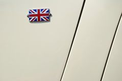 Small british flag on a car hood. Small british flag on an old car hood Stock Photo