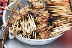 Small brochettes with cooked meat stock image