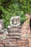 Small broken Buddha statue at Wat Mahathat temple, Ayutthaya, Thailand Royalty Free Stock Photography