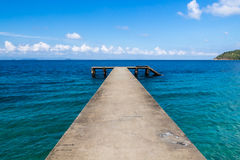 Small broken jetty. On a tropical island in the marine park. Malaysia royalty free stock photos