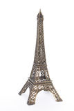 Small bronze copy of Eiffel. Tower figurine isolated on white background Royalty Free Stock Photos