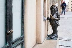The small bronze statue gnome by name - Bankomatnikiem, gnome taking money from an cash machine