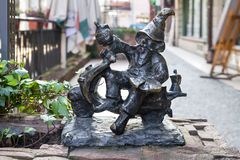 The small bronze statue gnome by name - Italudek, gnome on motor scooter