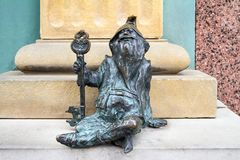 The small bronze statue gnome by name - Klucznik, gnome with key