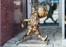 The small bronze statue gnome by name - Leprokonus, gnome with a barrel of gold