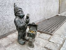 The small bronze statue gnome by name - Lombardzik, gnome with chest full of coins