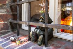 The small bronze statue gnome by name - Wiezien, gnome-prisoner behind prison grating