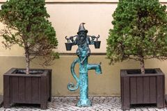 The small bronze statue gnome by name - Wodziarz, gnome with buckets on water column