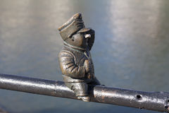 Small bronze statue of Good Soldier Svejk attached to the handrails at Kyivska embankment of the river Uzh in Uzhgorod Ukraine pho. To Stock Image