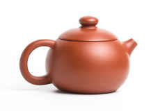 Small brown earthenware teapot with closed lid isolated on white royalty free stock image