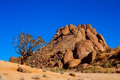 Boulder strewn hill. Small brown hill comprised of large round granite boulder in Richtersveld Stock Photos