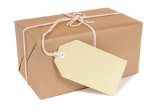 Small brown package with label Royalty Free Stock Photos